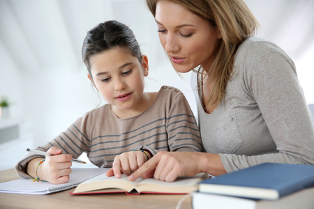 Bigstock mom helping kid with homework 59717999